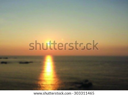blurred view of sunset over the sea for background - stock photo
