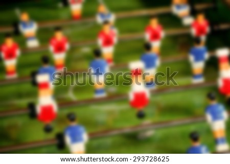 Blurred Vintage Foosball, Blue and Red Players Team Out of Focus in Table Soccer or Football Kicker Game, Selective Focus, Retro Tone Effect - stock photo
