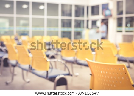 Blurred waiting room with empty chairs in pink tone - stock photo