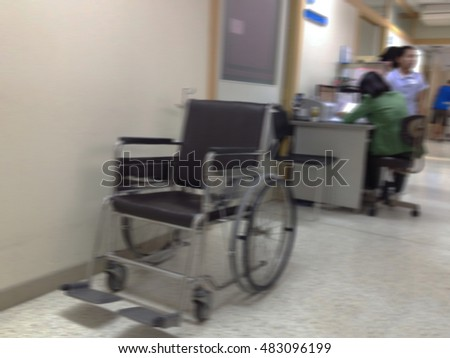 Blurred wheelchair parked in hospital room hallway