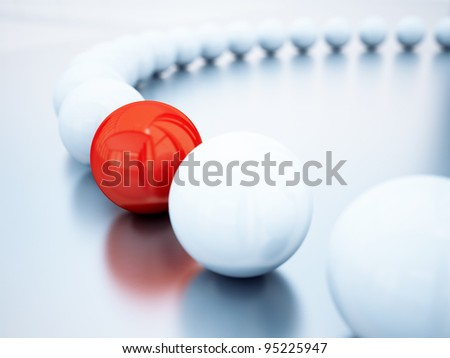 blurred white balls and red ball is in focus - stock photo