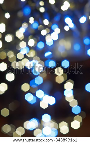 Blurred white, cyan and blue Christmas lights vertical background texture - stock photo