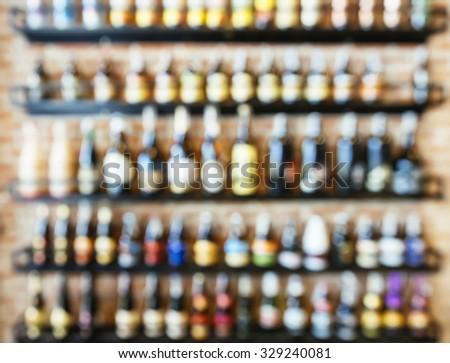 Blurred Wine Liquor bottles Display on shelf in Bar restaurant - stock photo