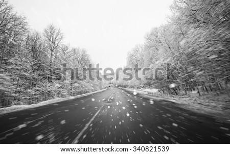 Blurred winter asphalt  road - stock photo