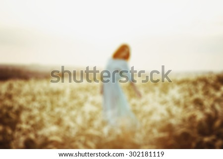 Blurred woman at sunset - stock photo