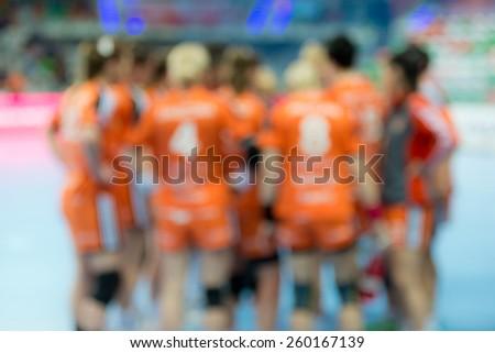Blurred women handball team. - stock photo