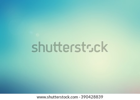 blurred wonderful background with rays flare lights.blur ideal backdrop concept.pastel cool tone color.colorful of blue gradient image:brigh soft sunshine day season:art vintage tone filter effect. - stock photo