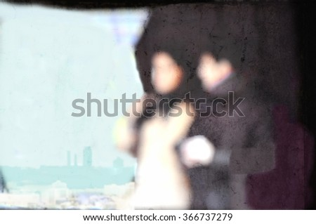 Blurred young couple walking at a shopping mall. - stock photo