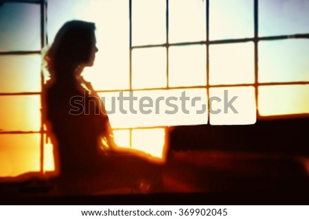 Blurred young woman figure working in an office. - stock photo