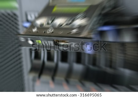 Blurred zoom of Computer Server with panel and raid storage in datacenter - stock photo