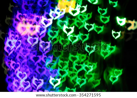 Blurring lights bokeh background of Devil hearts - stock photo