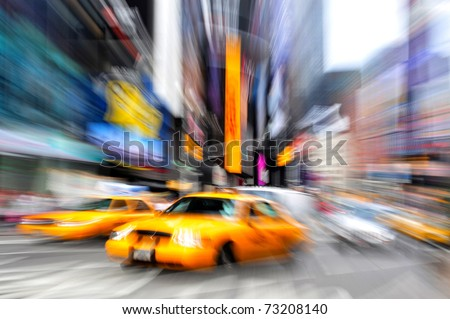 Blurry abstract photo of yellow taxi cabs in Times Square in Manhattan, New York in motion. - stock photo