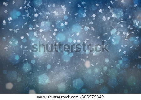 Blurry abstract snowflake Christmas and New Year illustration background. Beautiful blue colored Christmas and New Year Holiday greeting card. - stock photo