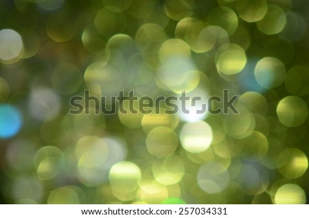 Blurry and defocused green lights / Abstract background / Festive and holiday theme - stock photo