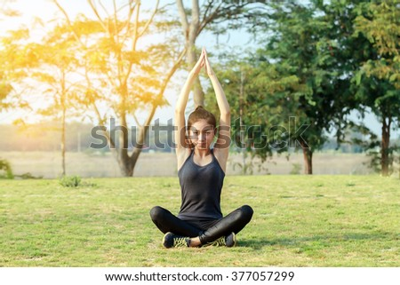 Blurry and soft focus of Athletic woman asia warming up and Young female athlete sitting on an exercising and stretching in a park before Runner outdoors, healthy lifestyle concept - stock photo