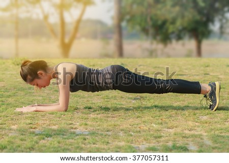 Blurry and soft focus of Athletic woman asian warming up and Young female athlete sitting on an exercising and stretching in a park before Runner outdoors, healthy lifestyle concept - stock photo