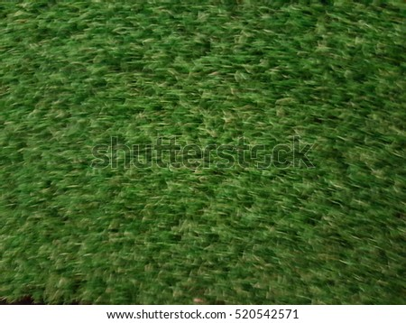 Blurry artificial green grass texture background