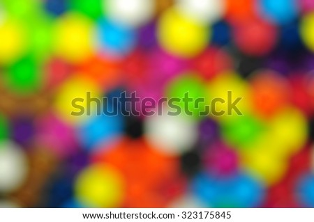 Blurry background image of colored crayon