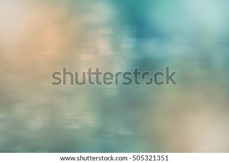 Blurry background in shades of blue, green and yellow
