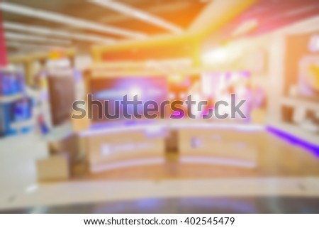 blurry background of a shop selling household appliances and TVs  was blurred for use as a background,can be used for text or display your products,vintage color - stock photo