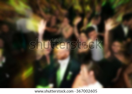 blurry background of men and women dance in nightclub - stock photo