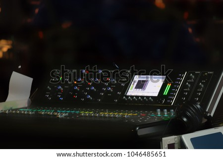 Blurry background of set of digital studio sound and music mixer for music recording, radio or tv broadcasting.