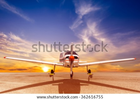 Blurry background Propeller plane parking at the airport - stock photo