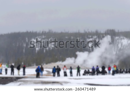 blurry background tourism waiting power of old faithful at yellowstone national park - stock photo