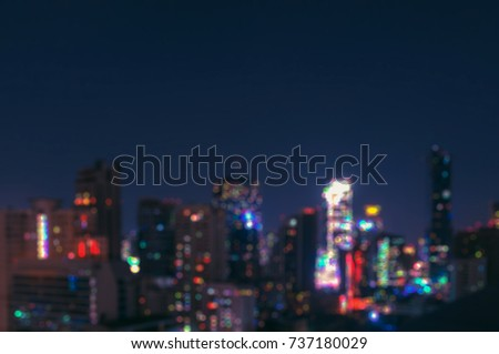 Blurry Bangkok night view with skyscraper in business district in Bangkok Thailand