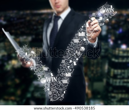 Blurry businessman in suit drawing creative checkmark business sketch on city background. Business concept