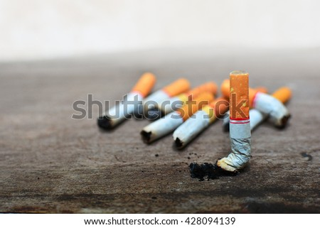 blurry cigarette background and ashes - stock photo