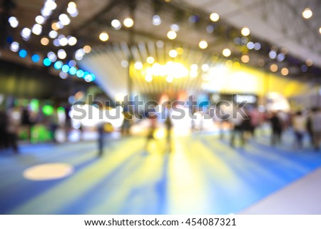 Blurry focus or defocused of lighting color effects of customer walk in market or shopping mall for use as Background - stock photo