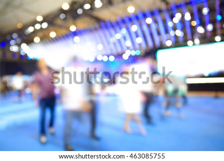 Blurry focus or defocused of lighting color effects of customer walk in market or shopping mall for use as Background