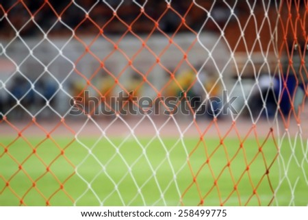 blurry football and soccer goal  net pattern  - stock photo