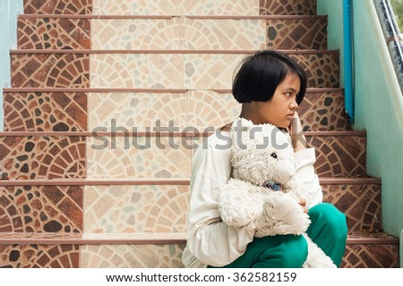 blurry,girl sad sitting alone at staircase in the park - stock photo