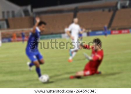 blurry goalkeeper jumps and blocks and Football(soccer) goalkeeper protecting the ball  - stock photo