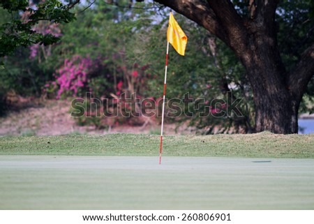 blurry Golf course in the countryside with flag for background  - stock photo