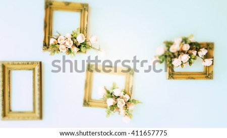 Blurry Green Wooden frame with flowers on the wall.