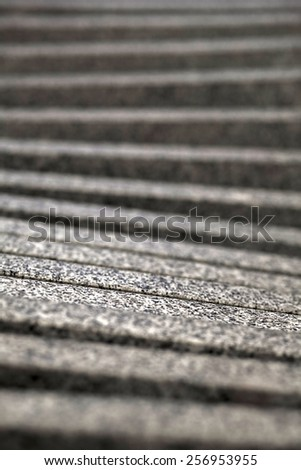 Blurry grey ascending steps - stock photo