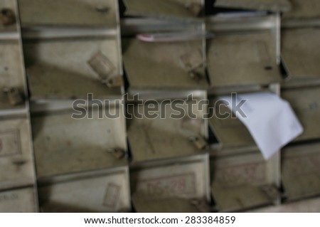 Blurry image and soft focus of letterbox slot with a letter - stock photo