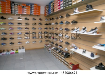 Blurry image of a shoe store inside.