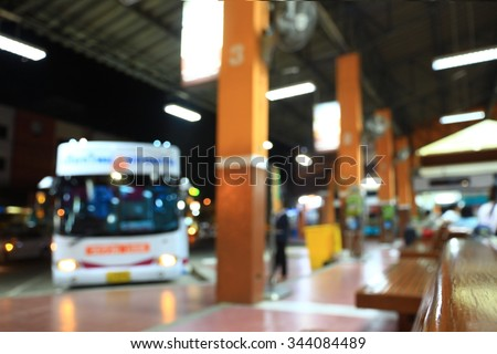 blurry image of Bus station at night - stock photo