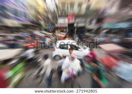 Blurry image of busy street market at Chandni Chowk, India with zooming effect