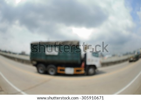 Blurry image of Container truck on free way. Photograph by fisheyes lens. - stock photo
