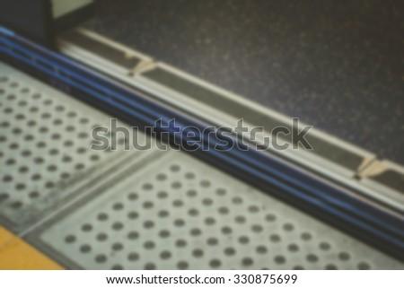 blurry image of Gap between platform and train when door open - stock photo