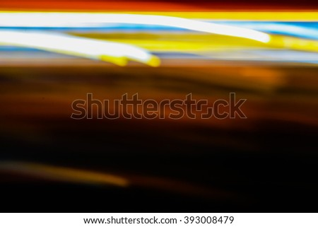 Blurry light effect from small size of multicolor lightbulb on dark background represent the abstract concept related idea. - stock photo