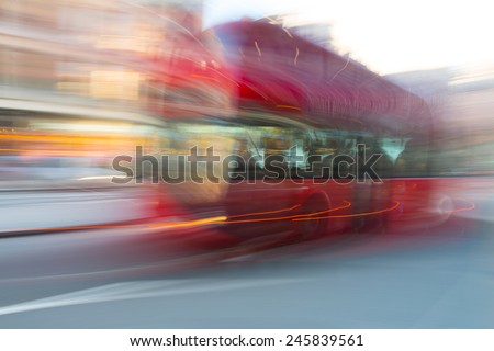 Blurry London bus in motion along the street - stock photo