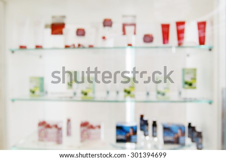 blurry medicine cabinet and store Skin protection cream and pharmacy drugstore for background - stock photo