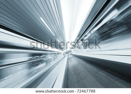 blurry modern escalator in business center - stock photo