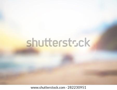 Blurry morning scene with orange field, sun burst, colorful blur sky. Summer holidays concept. - stock photo